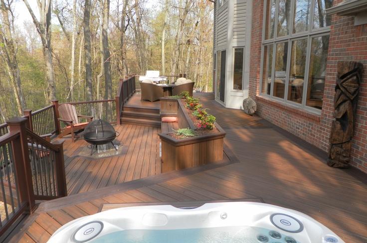 My Tiki Deck Oasis...Tecumseh, MI.  I designed & spec'd. Downhome Construction built. Trex decking & railing, Jacuzzi hot tub, Bosko Tiki pole, Granite inlays, La-Z-Boy Outdoor furniture.