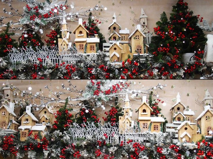 Paesaggio innevato. Idea creativa per vetrina di natale con casine in legno e alberi di natale artificiali. Pick di bacche rosse per dare colore al panorama. Clicca e scopri come farlo