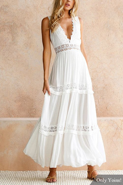 Sweet maxi dress in white with contrast lace panels throughout. Lightweight fabric + topped with a plunge V-neck and sleeveless detailing. High-rise A-line skirt bottom with a scallop hem. Finished with low v-back with invisible zip.