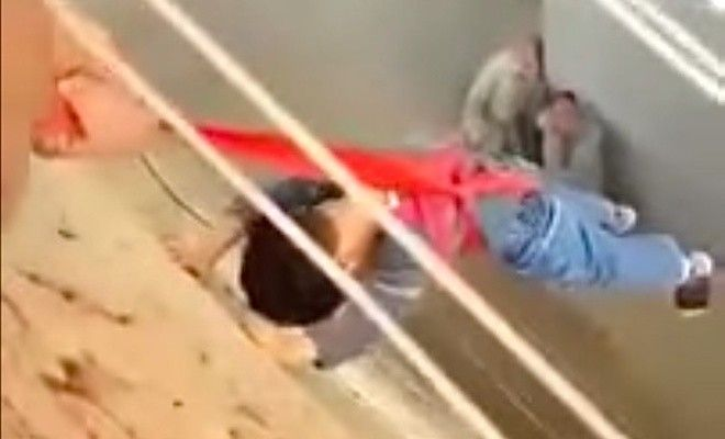 Dad Hangs Son Over The Side Of A Building After Losing House Keys