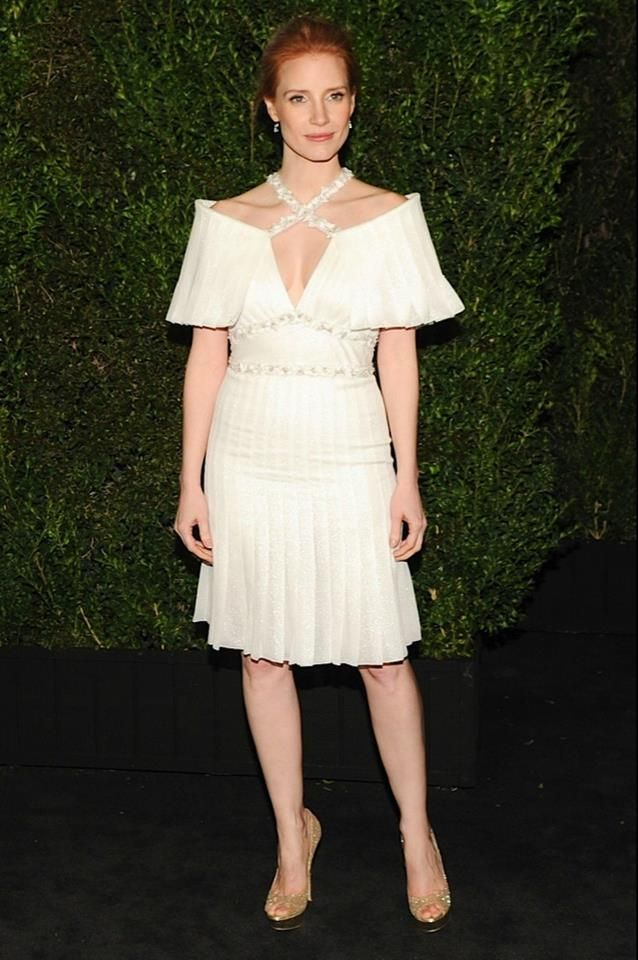 Jessica Chastain wore a short pleated flare dress in white lamé chiffon, look 25, from the Spring Summer 2013 Haute Couture Collection #Couture #Chanel #Summer #fashion #stunning