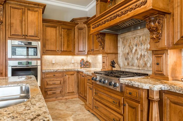 Chef's kitchen with alder cabinets and high-end appliances. Custom luxury home along the country roads in Lincoln, CA. Mediterranean style on 10 rolling  acres. Lots of oak trees, barn, and a pond. Architectural design plan - 2007 Award Winner at Parade of Homes in Orlando, Florida. Design by Weber Design Group. Cabinets by Frank Jacob of Roseville.