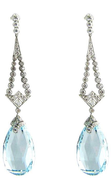 Art Deco Teardrop Aquamarine Diamond Platinum Earrings. A pair of platinum Art Deco earrings, each comprising a briolette cut aquamarine, estimated to weigh 14.92 carats in total, suspended from a geometric diamond top, estimated to weigh 1.35cts in total, H colour, SI clarity. c 1920s