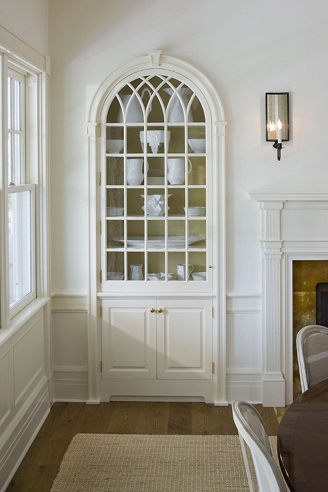 The ONE White Trim Color That Works Every Time - laurel home | White on white. Gorgeous cabinetry and millwork by builders George Hummel and Associates | I adore this living room, the millwork and that amazing built-in cabinet and of course the gorgeous white walls!