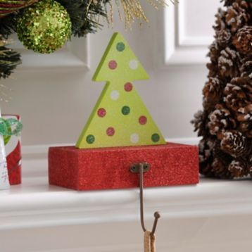 Hang your stockings by the mantle with care with our Wooden Christmas Tree Stocking Holder! #Kirklands #HollyJolly #holidaydecor
