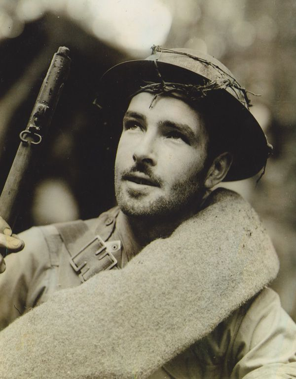 This photo was taken by famous Australian War photographer Damien Parer. It is of  James Aloysius Canty on the Kokoda trail.