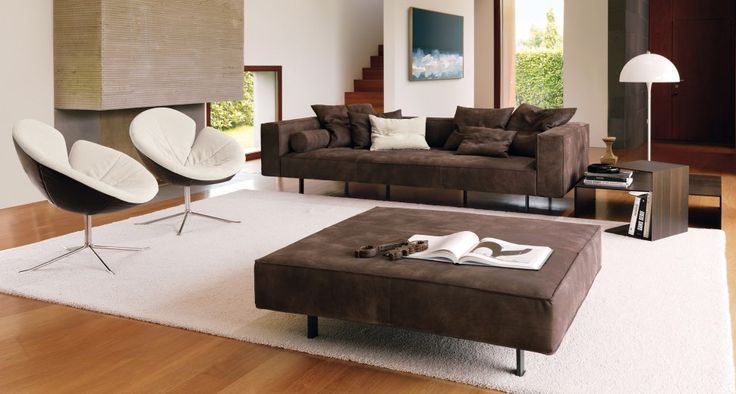 Contemporary design and elegant lines | ZEROCENTO is a sofa characterized by a system of padded elements proposed in two versions of depth, 93 and 120 cm. The model, with feet off the floor with rectangular metal painted matt anthracite, stands out for its contemporary design, elegant lines and soft padding on the seat side. It is complete with fluffy pillows in various types and sizes.