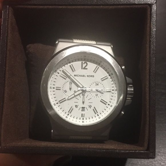 Michael Kors Men's watch Michael Kors Men's watch white/silver MK8153 retails for $250 plus tax (this is a men's watch) comes with original box! Michael Kors Accessories Watches