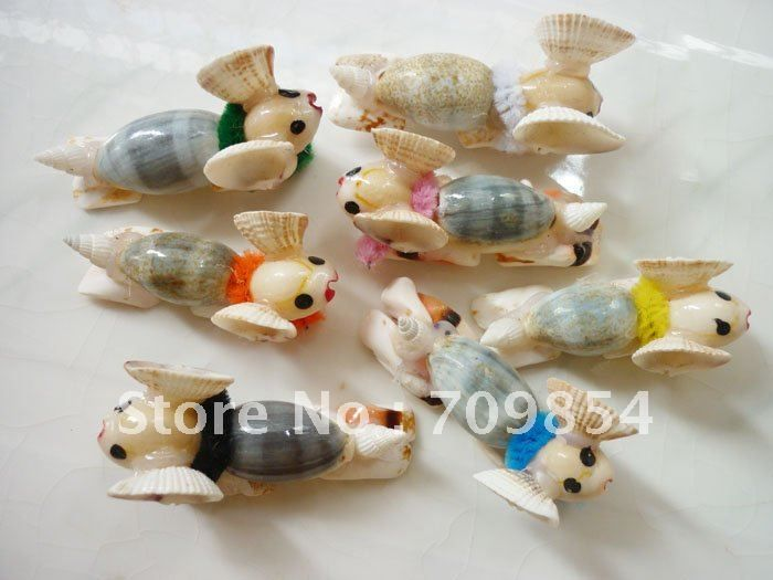 17 best images about shell craft on pinterest conch for Animals made out of seashells