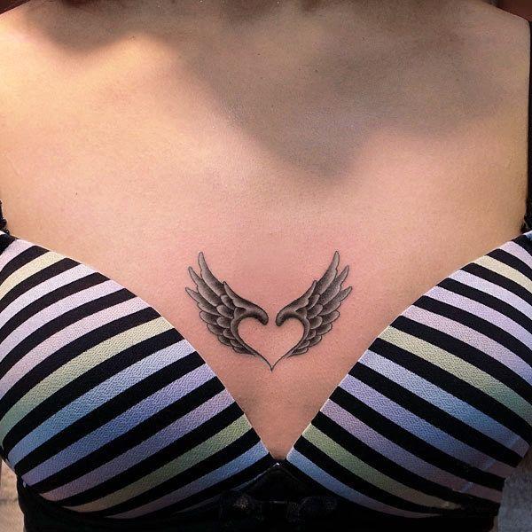 Wings make a heart tattoo