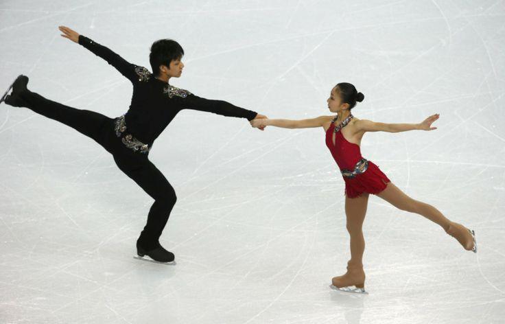 Narumi Takahashi and Ryuichi Kihara during the figure skating team pairs' short program at the Sochi 2014 Winter Olympics