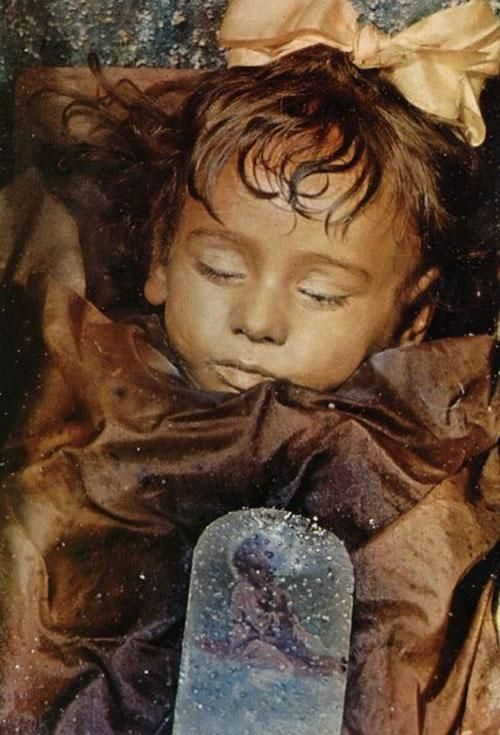 Deep in the Catacombs of the Capuchin Monks in Palermo, Sicily, inside a tiny glass casket lies the body of little Rosalia Lombardo. When she died in 1920 of pneumonia her father, General Lombardo, was devastated. He sought the services of Italian Embalmer Alfredo Salafia to preserve her. Using a mixture of chemicals including formalin, to kill bacteria, zinc salts to petrify the body and its organs, alcohol, salicylic acid and glycerin.