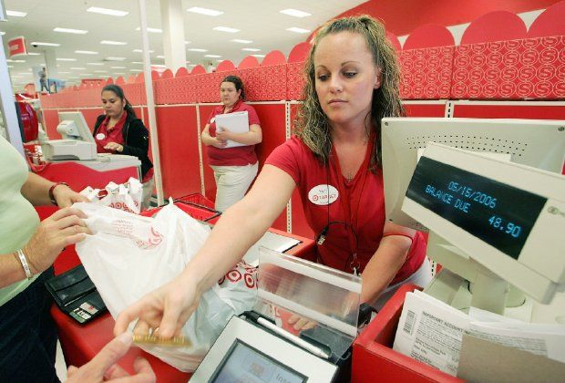 Target cashier rings up customers at a Target store May 15, 2006 in Albany, California. (Photo by Justin Sullivan/Getty Images)