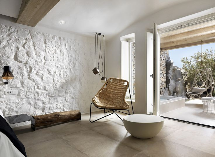 Kensho Boutique Hotel & Suites. Mykonos. Collection: Tina armchair by Benedetta Tagliabue and Nautica swing chair by MUT Design. Indoor. Year: 2016.