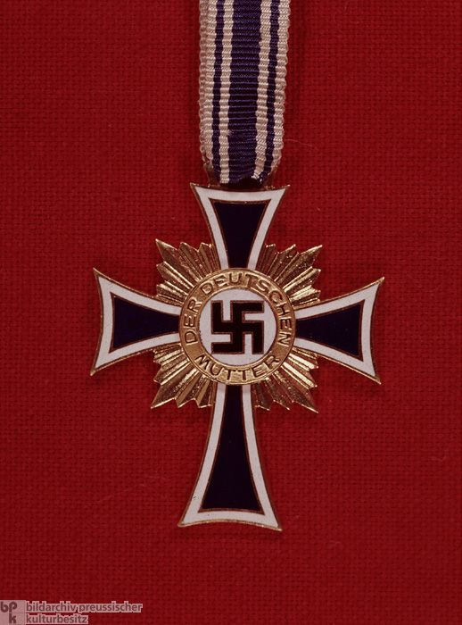 """One manifestation of the Nazi """"cult of the mother"""" was the """"Cross of Honor for the German Mother"""" (also known as the """"Mother Cross""""), which the NSDAP awarded in Hitler's name to mothers with four or more children. The Mother Cross was first awarded on Mother's Day in 1939; that year alone about 3 million women qualified for the honor, which was supposed to be awarded only to """"genetically fit,"""" politically reliable, and socially worthy German mothers. The crosses were awarded according to the…"""