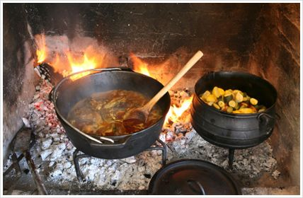 South-Africa - Lamb Potjiekos: This is very South African, almost like a braai as it also involves a fire and a cooler box, family and friends and the odd argument or two about who is stuffing up the potjie by stirring it or adding too much sauce