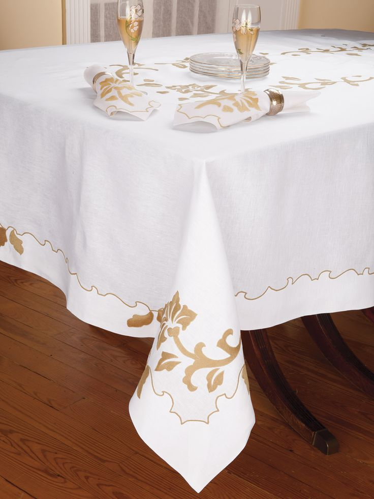 A great conversation piece for the most special dinner guests, finest Italian linen is artistically embroidered by hand with a creative free-form floral design and curvaceously innovative frame. Imported in White with Gold, this extraordinary tablecloth is available with matching placemats and napkins. To proudly own or gift someone special.