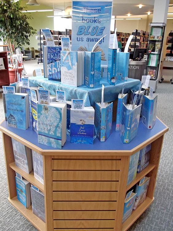 """""""These books 'blue' us away"""" ... what a fun library display idea!"""