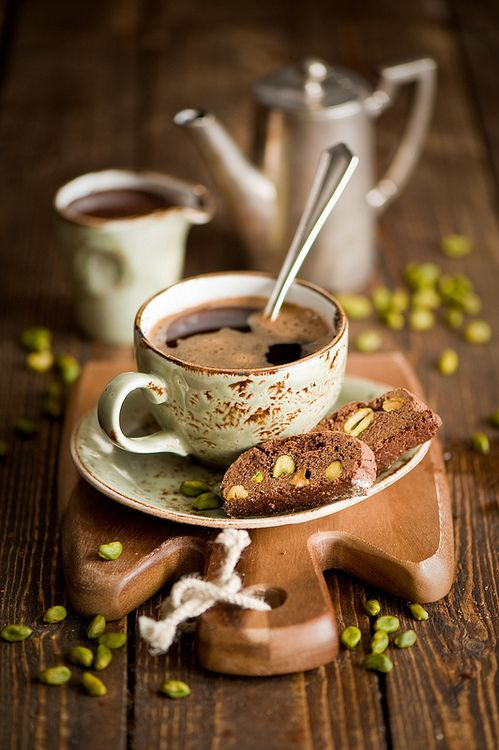 A cup of coffee with biscuits.                                                                                                                                                                                 Mais
