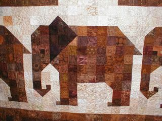 Elephant Quilt Pattern   And she stitched an elephant pattern in the 'paths' of the elephants!