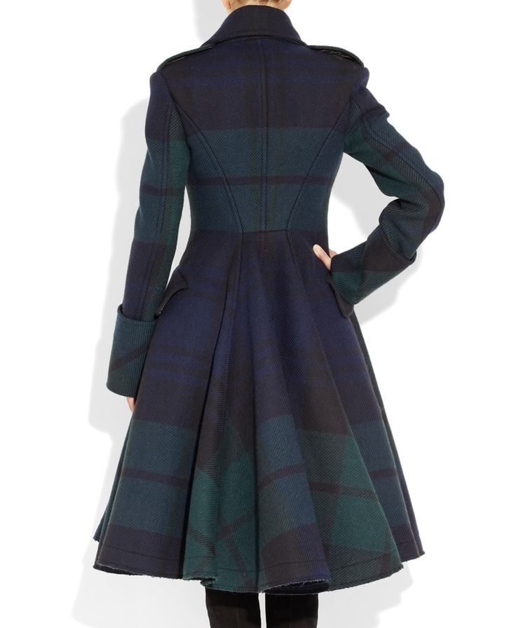 McQ Alexander McQueen The Black Watch coat of green, blue, and black plaid. Fitted bodice with asymmetrical front leads to a fabulously full pleated skirt.