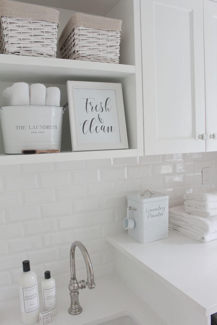 @jshomedesign home  laundry room, white subway tile, white quartz countertop, patterned tiles