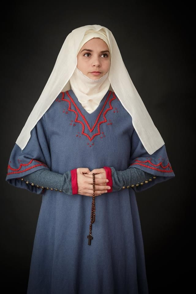 woolen cotehardie with golden metal buttons, trimmed with cashmere. linen headwear. heavy woolen surcote with woolen hand - embroidery 1st. half of 14th century