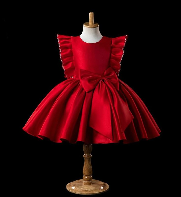 Ruffle Sleeve Dress-Beautiful Round Neckline Beaded Ruffle Sleeve Big Bow Knee Length Baby Infant Toddler Little & Big Girl Party Dress. Available from 9 months until 14 years. Material: Cotton, satin & tulle mesh. Colors: Red, white, black, green, navy blue. Please do compare your little girl measurements with our size chart or you may leave a note your little girl's height, bust and waist measurements so we can process it and send you the right size.