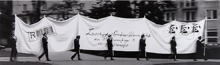 """The Letter is a tapestry over ten metres in length which depicts a reconstruction of Tadeusz Kantor's 1967 happening of the same name. However, Macuga's gigantic """"letter"""", carried by eight postmen, is addressed to the Zachęta Gallery, whereas Tadeusz Kantor's message was sent to the Foksal Gallery. The context here is the history of the Zachęta Gallery, especially in the tempestuous last decade of the 20th century, when contemporary art ignited protests and aggressive reactions (e.g. Daniel…"""