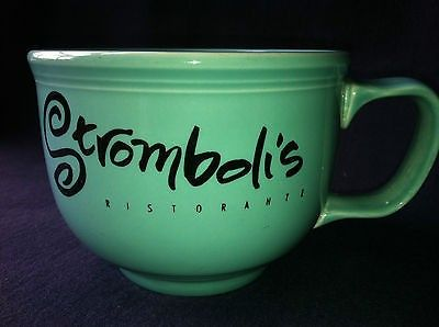 Fiesta® Dinnerware Turquoise Disneyland Hotel Stromboli's Ristorante Jumbo Mug. Made by Homer Laughlin China Company. The mug features the lettering, 'Disneyland Hotel' along with the classic Disney Tinkerbell  logo on one side; and the lettering, 'Stromboli's Ristorante' on the reverse side | WorthPoint