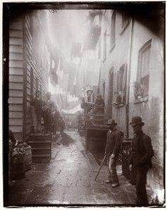 Bandits' Roost, an alley at crime-ridden Mulberry Street in New York. Jacob Riis, Richard Hoe Lawrence, and Henry G. Piffard, photographers. Bandits' Roost, 1887–1888. Museum of the City of New York. Gift of Roger William Riis.