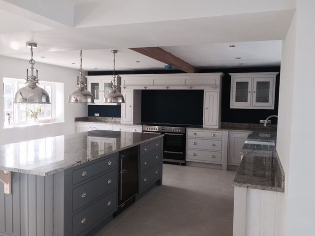 Handmade kitchen by Aberford Interiors painted in Farrow and Ball Blackened and Plummett