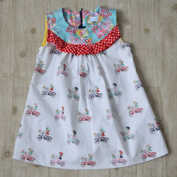 Girl Toddler Dress with girl on bicycle print