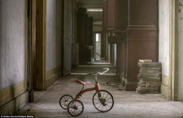 Spooky: With an abandoned tricycle sitting in an empty corridor, this derelict but once grand mansion could be the setting for The Shining