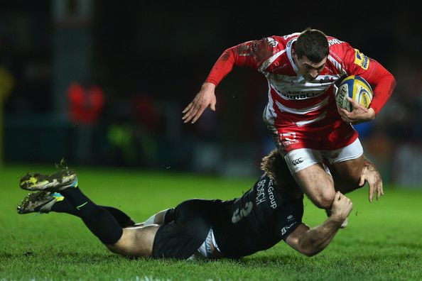 Jonny May (R) of Gloucester is tackled by Marcelo Bosch of Saracens during the Aviva Premiership match between Gloucester Rugby and Saracens at Kingsholm Stadium on January 9, 2015 in Gloucester, England. (January 8, 2015 - Source: Michael Steele/Getty Images Europe)