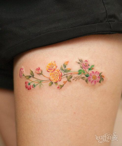 Cute Floral Thigh Tattoo by Graffittoo