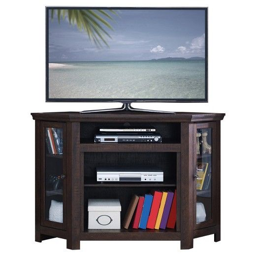 Enhance your family's living room with this gorgeous walnut finish entertainment center. This unique corner unit is the perfect storage unit and display piece. The durable construction features an space saving design fitting comfortably into the corner of your room. 2 see through doors protect the 3 storage shelves. A centered open shelf can be used to display your items or house your electronic components. This a beautiful, and functional, piece of furniture for your home.