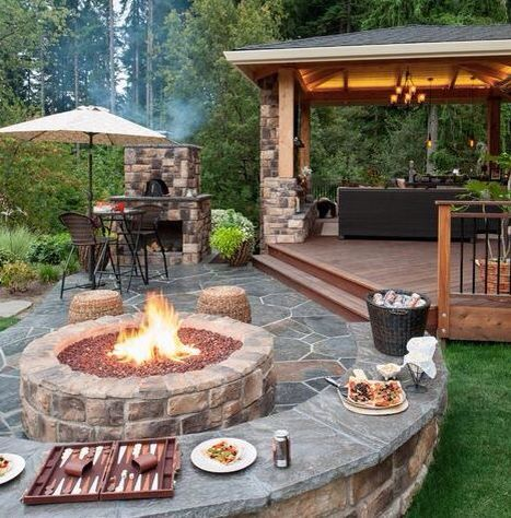 Pergola, fire pit, fireplace all make for the perfect backyard escape!