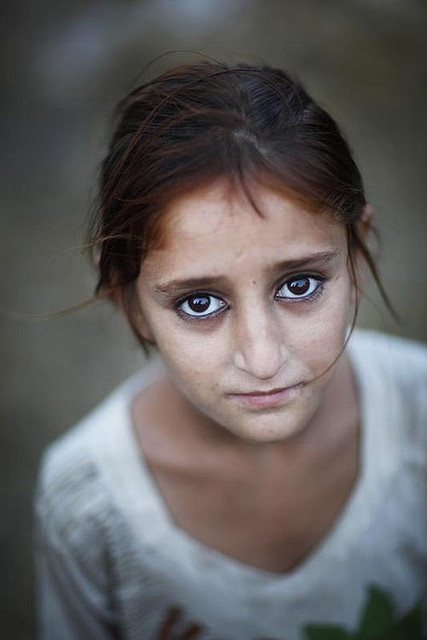 Pakistan - what a sad looking girl. Not surprising, given what the news often is out of Pakistan and the treatment of women.