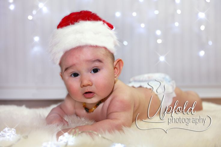 Christmas newborn baby boy. Image by Upfold Photography, Auckland. Fur-trimmed Christmas Hat by Grace Ave Props & Things, Auckland.