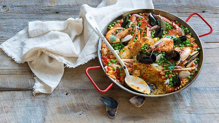 Everyone's favourite seafood and rice dish: #paella with crab, prawns and chicken (paella mixta). Listen to the audio recipe.