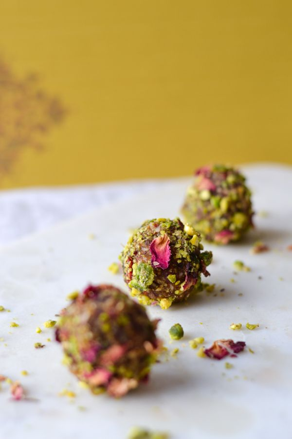 Energy balls made with rose and pistachio flavours creating an indulgent protein packed healthy snack!