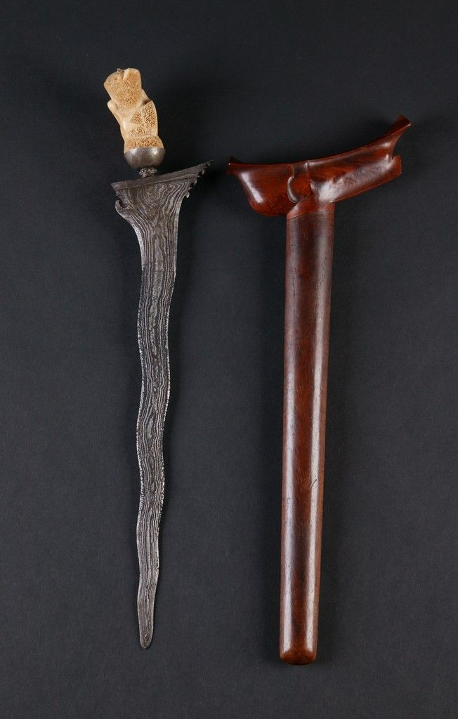 Indonesian Kris with scabbard. Check out that pamor (folded steel pattern). Bali Floating Leaf Eco-Retreat. http://balifloatingleaf.com/
