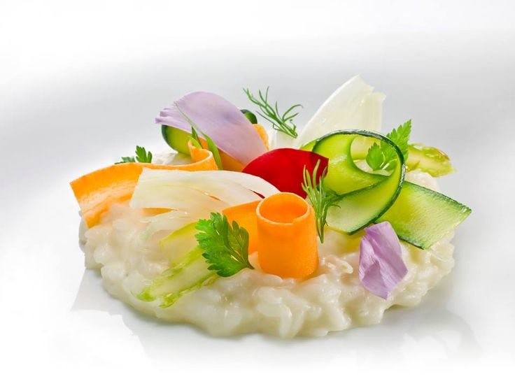 "Risotto with olive oil and Grana Padano, vegetables and scampi ""in pinzimonio"" 