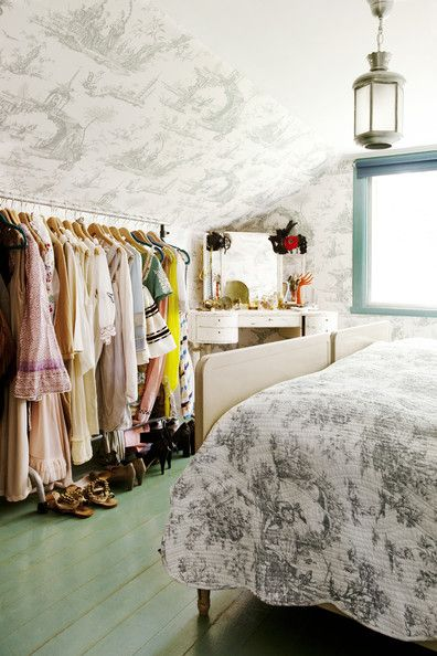 Wall Treatment Country Photo - Toile wallpaper and a rolling rack of clothes in a bedroom