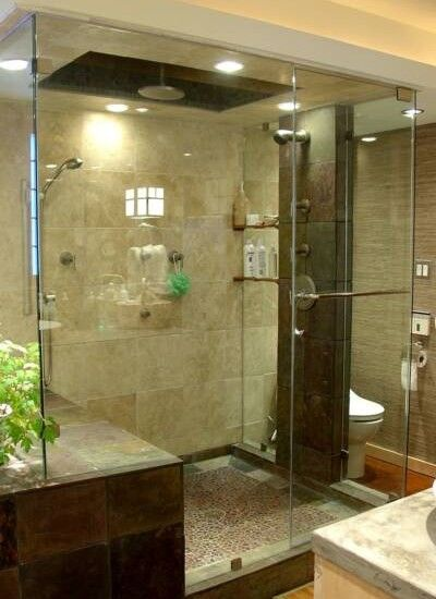Small Master Bathroom Ideas  (these don't seem small...love the multiple shower heads & bench)