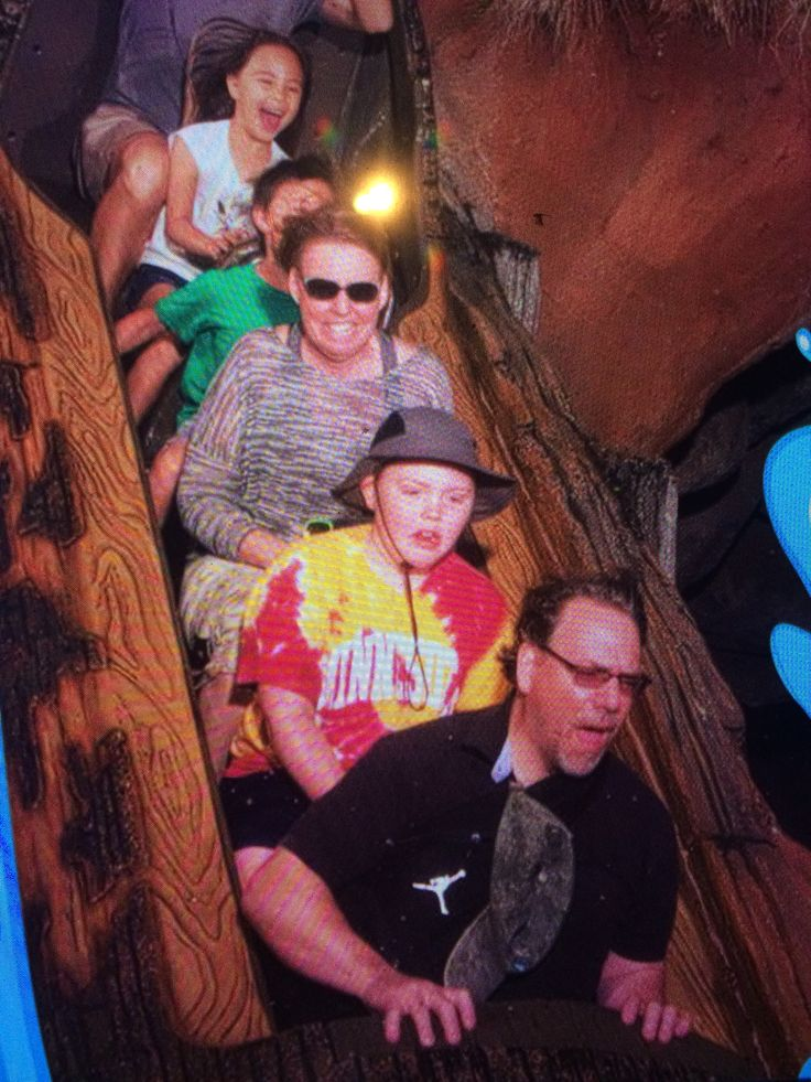Riding Splash Mountain. Grandpa in front, Adrian and grandma right behind.