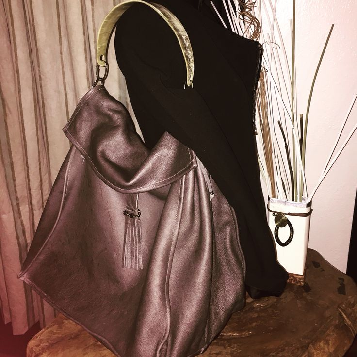 Grey soft leather bag. Entirely hand made, one piece only. Made in Kenya by Italian designer.