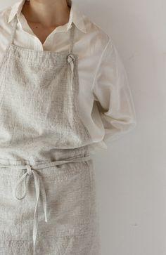 archive 2012 evam eva|kondo knit co. Ltd - knotted neck strap through grommet hole is adjustable. Big lower pocket, self-fabric neck and waist straps