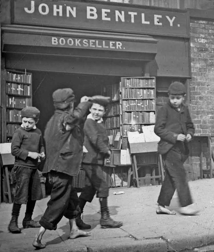 Booksellers Liverpool. Note not all the children have shoes brrrr. C1905
